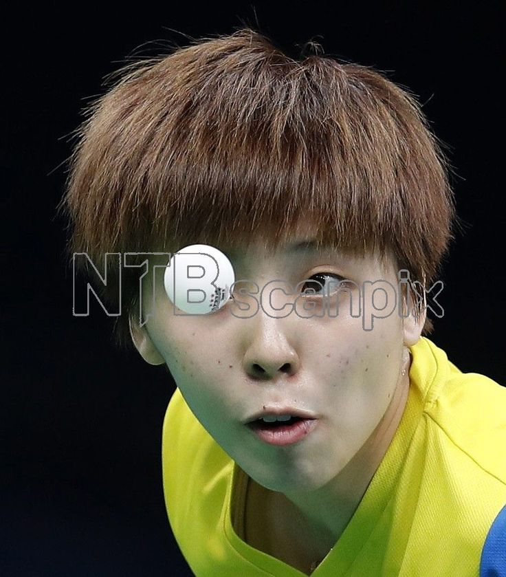 Yihan Zhou of Sinapore in action against Ning Ding of China during the women's Team semifinals game of the Rio 2016 Olympic Games Table Tennis events at the Riocentro in Rio de Janeiro, Brazil, 15 August 2016. EPA/JEON HEON-KYUN