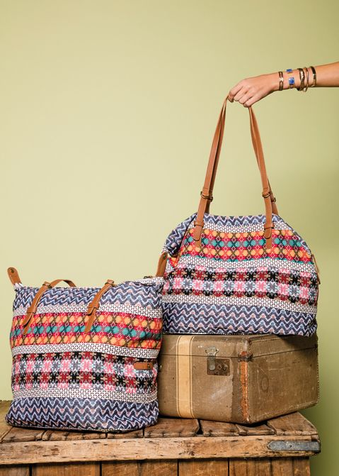 Traditional Nepali fabric and luscious leather make this bag a one-of-a-kind find. Wear it slouchy for a unique accordion shape, or unsnap the sides for a more square, structured look. | Kathmandu Bag