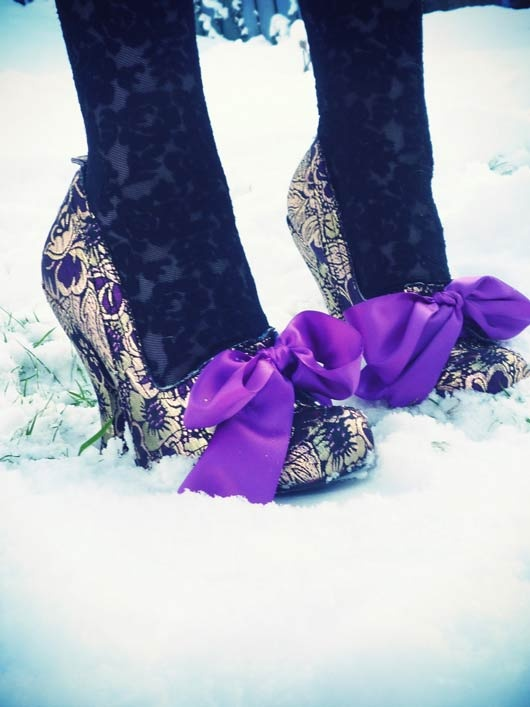 Irregular Choice metallic and purple pumps with purple bow. From Schuh.