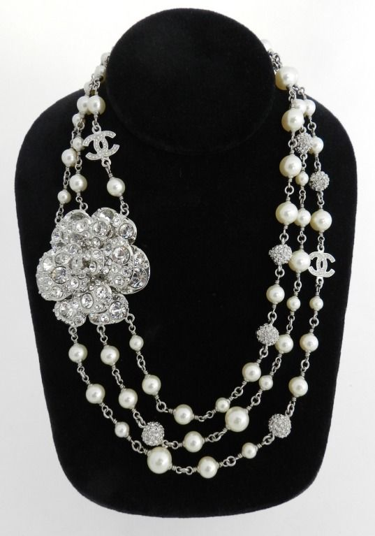 Chanel 12C Clear Rhinestone Triple Strand Camelia Necklace | From a unique collection of vintage multi-strand necklaces at http://www.1stdibs.com/jewelry/necklaces/multi-strand-necklaces/