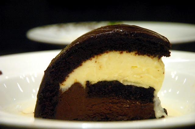 Italianni's classic Tartufo, moist chocolate cake layered with white and dark chocolate mousse