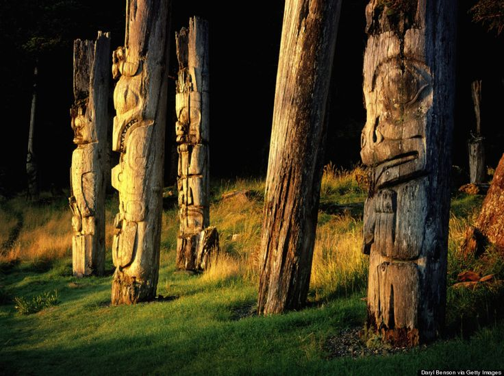 Visit the totems in Skung Gwaii Village at dawn.