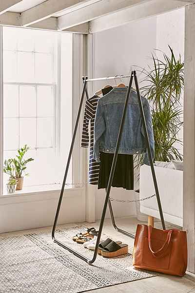 Collapsible storage rack made from durable steel. Perfect to store your favorite pieces + easy to tuck away when not in use.