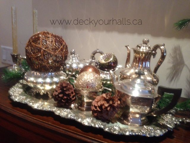 Dressing up a client's tea service set!  Decorating homes and biz for the Holidays in Toronto.  www.deckyourhalls.ca
