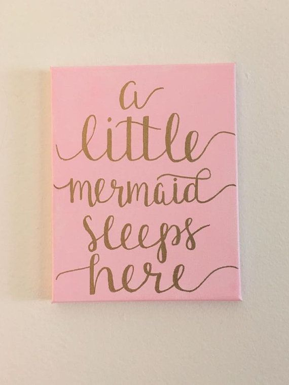 Canvas Sign  In picture: a little mermaid sleeps here Hand lettered calligraphy text written in gold on light pink painted canvas sign 8 x 10