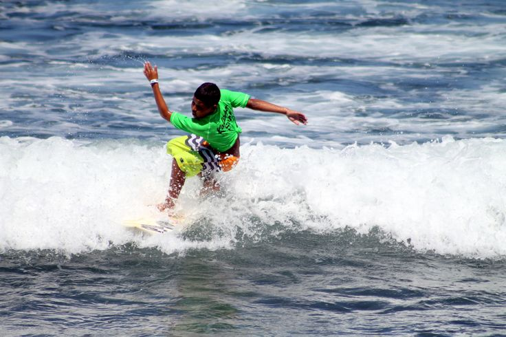 Another shot from the competition, this little kid was a monster on the waves, here he is mid trick on a wave.