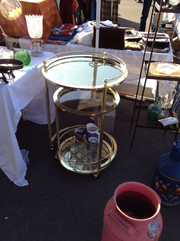 This brass and glass has a table that swivels out. Sold to a very charming couple.Charms Couples, Bar Carts