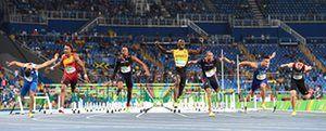 Jamaica's Omar McLeod crosses the finish line to win the men's 110m hurdles final. Photograph: Olivier Morin