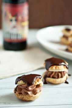 Chocolate Porter Cream Puffs.  Made with puff pastry, dark chocolate, and a luscious porter beer that adds a wonderful flavor and complexity to the cream filling & glaze. Though they look like you fussed all day, they are quick and easy to make.