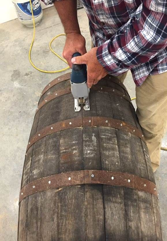 cutting barrel in half - DIY whiskey barrel table