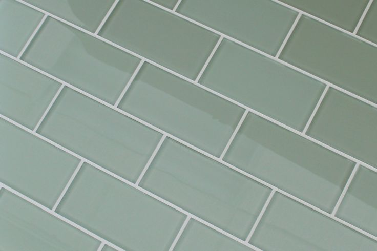 "A light sage green 3x6 glass subway tile. A very mellow green that will look great in your kitchen! 1 Sq Ft: $16.99 3"" x 6"" Sample: $6.99 Dimensions: 151mm x 74mm x 8mm (3"" x 6"") Weight: 3.8 LBS/ Sq F"