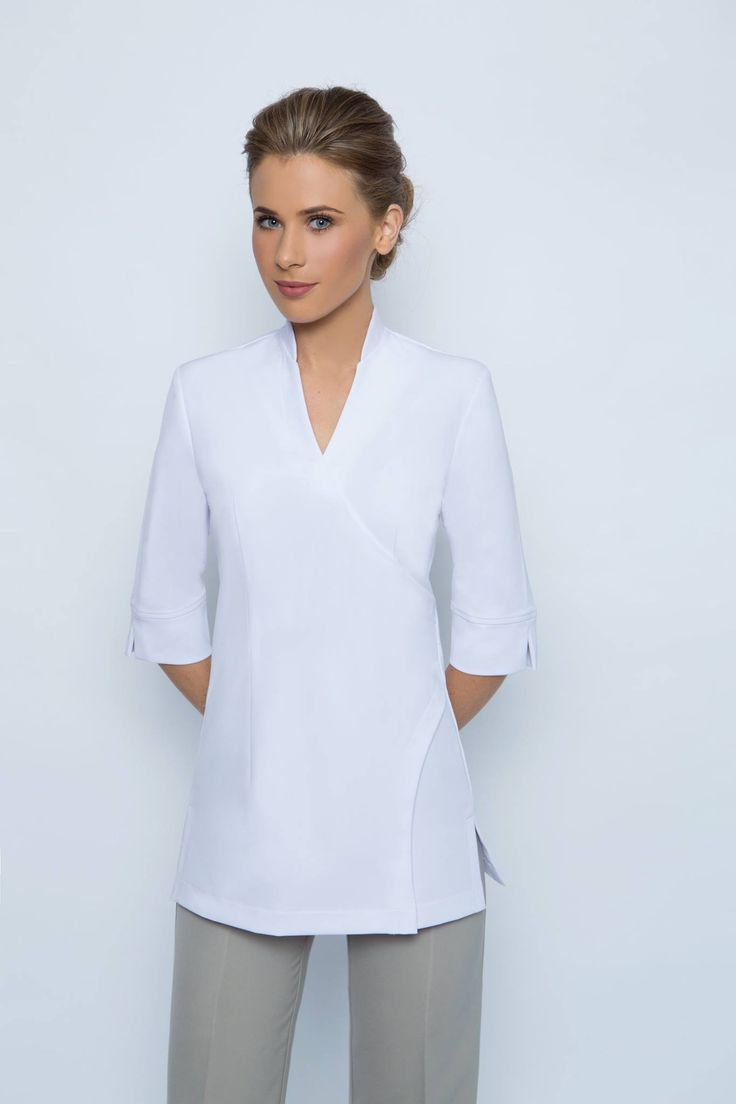 SPA 20 tunic - White. This tunic has a 3/4 sleeve with a small split at the elbow. A mandarin collar with a 55cm zip at the rear. ( Similar style to the SPA10 tunic, without the buttons & a 3/4 sleeve). This tunic is long enough to cover your backside. Made with easy wash and wear corporate grade fabric. Available in black or ( white is made to order only- allow 2 weeks for the white to be made ). Available in sizes 6-24.