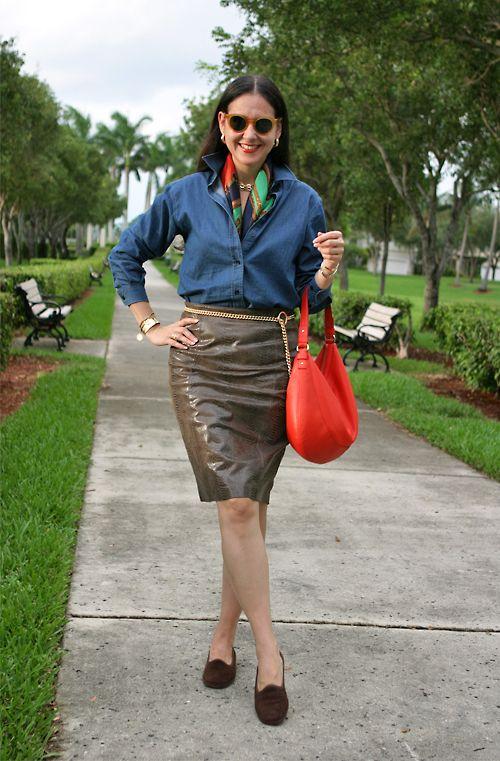 September 25, 2012  http://www.akeytothearmoire.com/post/32258274974/denim-take-two  #silk scarf #Ralph Lauren #professional #work appropriate #navy #denim #leather #leather skirt #denim shirt #orange #green #chain belt #Kate Spade #Cutter & Buck #loafers #slippers