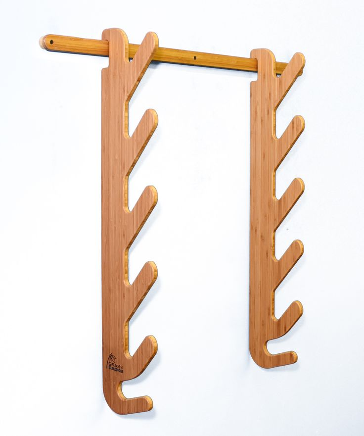 Stylish Bamboo Ski Rack for the Equipped Skier, Paddler, and Fisherman. Our Hallsteiner Series is designed to display skis horizontally, while giving you the option of storing your skis together or se
