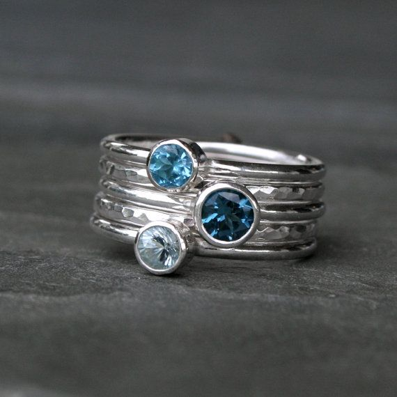 Deep Sea Stacking Rings.  Stacking rings in beautiful blues.  Five handmade sterling silver stacking rings. Three smooth ring bands are set with a gorgeous variety of blue faceted gemstones. 2 plain ring bands are given a hammered texture & a bright polished finish. Wear them all together, mix and match, or wear one elegant ring at time.  5mm London Blue Topaz  4mm Aquamarine  4mm Swiss Blue Topaz  Each ring is 1/16th of an inch. Together the stack is just over one quarter inch wide (5/16)…