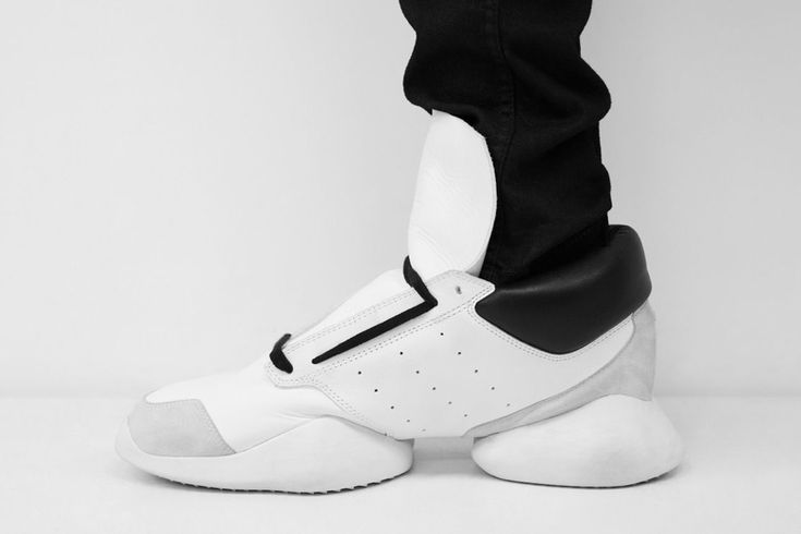adidas by Rick Owens Spring/Summer 2014 The sneakers feature Rick Owens' signature minimalist aesthetic in a single silhouette composed of leather and nylon mixes in the colors black, white, gray, pearl, and bone.