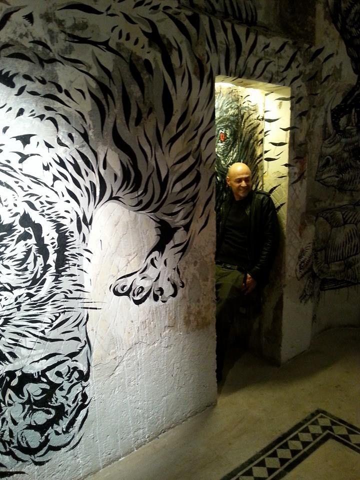 David Diavù Vecchiato with his mural inside Sacripante Gallery,