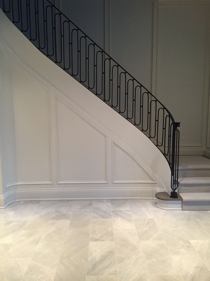 Beautiful classic curved staircase with traditional panelled wall detail | Gluckstein Design