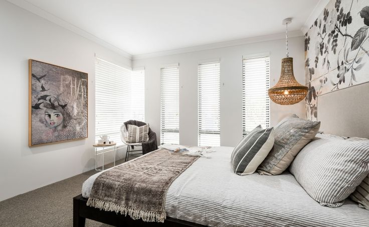 Secluded master suite located at the front of the home with walk-in robe and luxurious ensuite