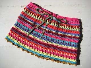 Just lovely. And very simple. Great for kids over leggings in the winter. Use scraps, and a great project to try out different stitches.