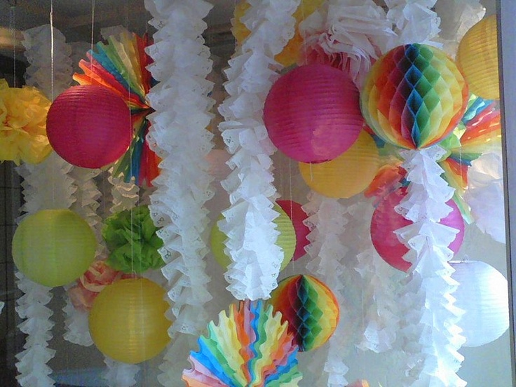 paper doily garlands with paper fans and lanterns.  Love the doily garland!