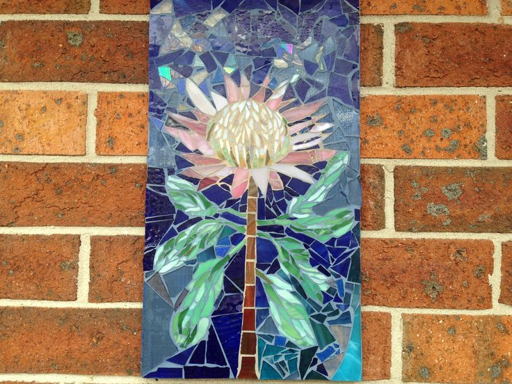 Jan 2015, finally decided what colours of grout to use. Inside the protea flower I used a light colour called Sandelwood, the rest was grouted with a lovely blue. very happy with the final result.