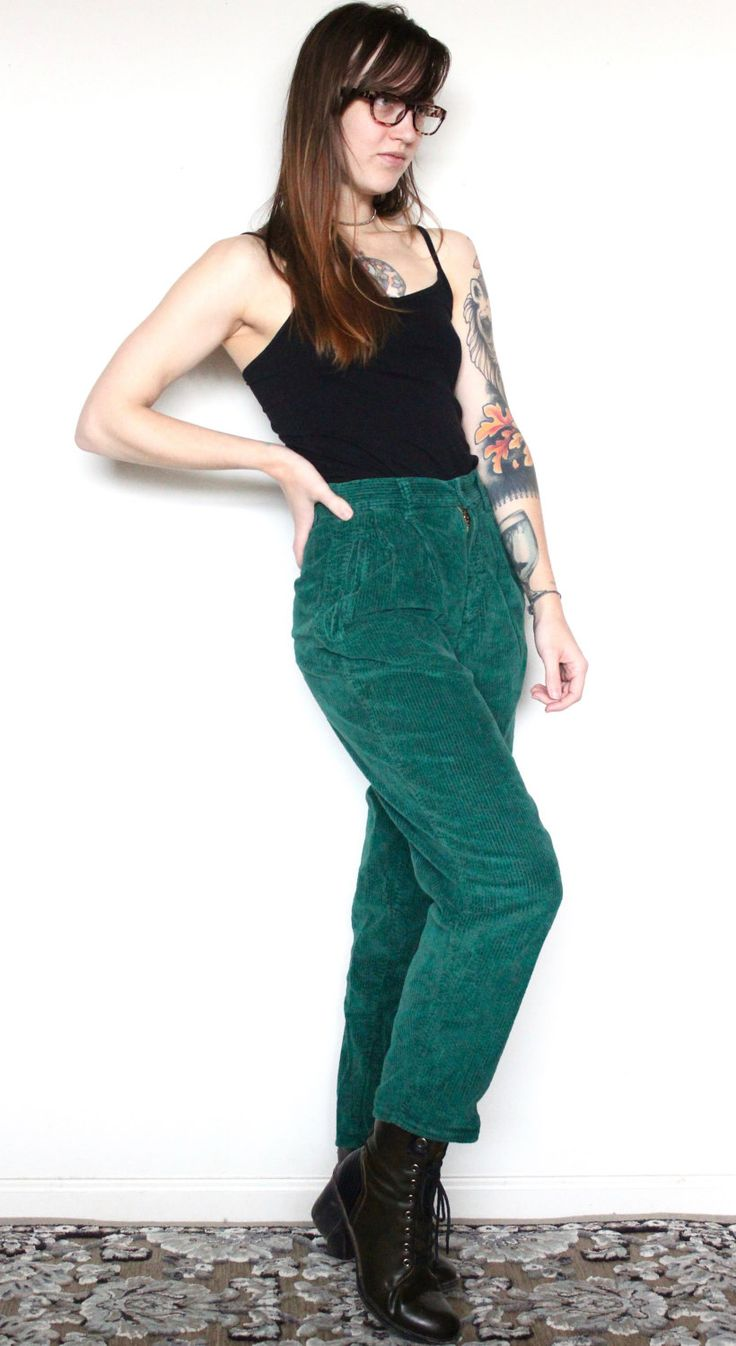 Sought After Vintage  www.soughtaftervintage.com  These green corduroy mom pants are so 80s I can't stand it! This pair of high waisted jeans are such a deep lush green color and have an awesome silhouette. They're fitted in the top half and have a straight but roomy cut going down the legs. They're perfect if you have boots to wear underneath them and style well with tight or cropped tops. These have traditional belt loops, a plastic button, a zipper fly, and two side pockets.