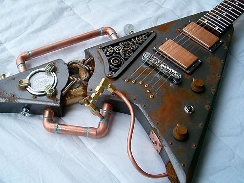 A length of copper pipe, a custom-made oil gauge, handful of intricate gears and a rusty/hammered paint job later and it's the finest example of a Steampunk guitar you will ever, ever see. Description from neovictoriansteampunk.com. I searched for this on bing.com/images