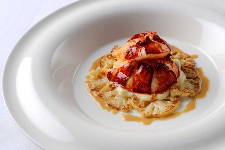 POACHED LOBSTER TAIL WITH CAULIFLOWER AND LOBSTER BUTTER SAUCE  To prepare the lobster, place it into the freezer for half an hour. This will render them insensate. In the meantime put a big pan of water on to blanch th