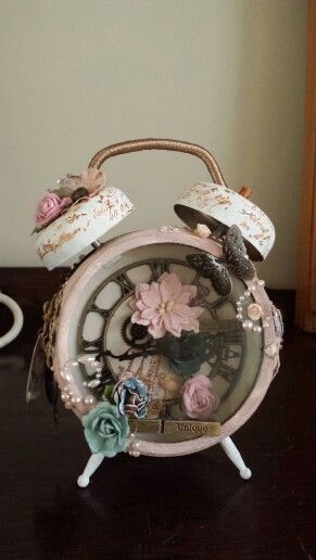 My Tim holtz altered clock using Tim holtz distress crackle paint, distress ink, prima findings, flowers & pearls, graphic 45 staples
