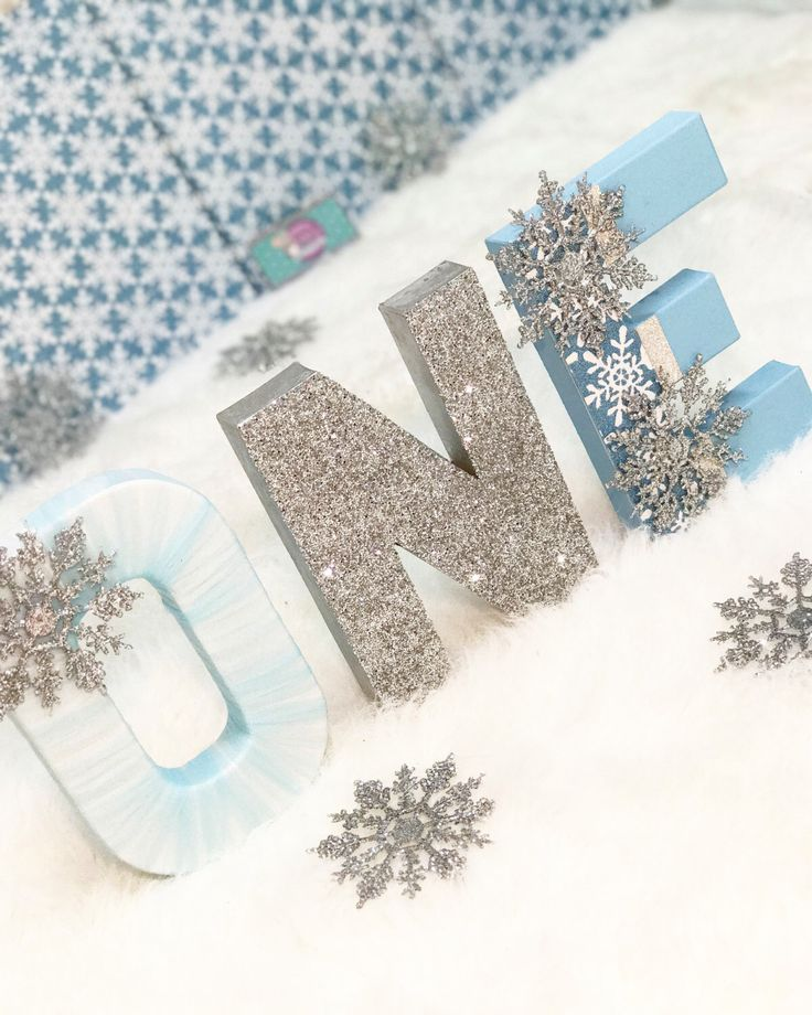 One Letters - Snowflake Decor - Snowflake Decorations - Winter Wonderland Decor - Winter Onederland - First Birthday Party - Glitter Letters by IttyBittyMilestones on Etsy https://www.etsy.com/listing/468970755/one-letters-snowflake-decor-snowflake