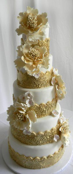 5 tier wedding cake with gold accents