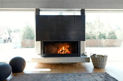 Great fireplace, with rug, basket and squishy pouffy things to soften the look.