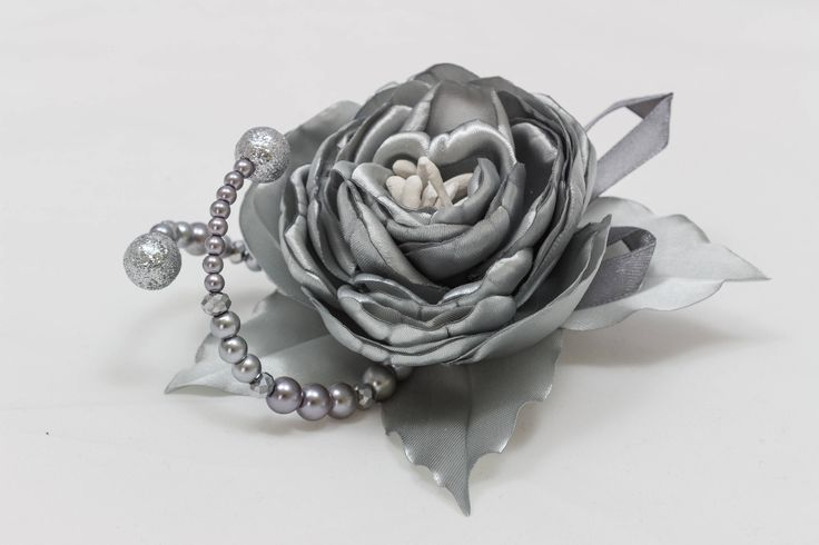 A personal favourite from my Etsy shop https://www.etsy.com/ie/listing/578631069/fab-kanzashi-satin-flower-silver-rose