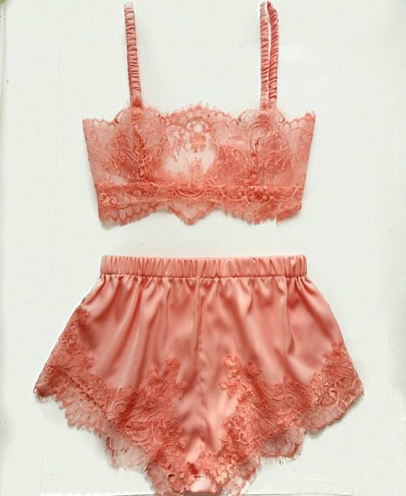 """This lingerie set was inspired by vintage glamour of the 1930s. Bralette made from delicate Chantilly lace in flirty peach color, with silk bra straps. Classy French knickers made from soft and comfortable silk satin, on the sides decorated with lace. The bra has a plush elastic band, satin elastic straps which are fully adjustable, and a hook and eye closure at the back. In this set you feel yourself like a vintage diva. Size Guide: Extra Small - 34-35""""Bust, 24-25 Waist, 33-34 Hips Small…"""
