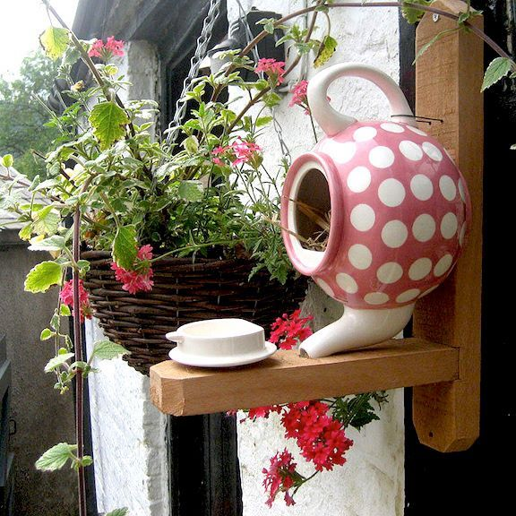 Teapot Bird House: how creative is this!  I'm all the time seeing old teapots and teapot flower vases at flea markets and in antique shops. Must do!