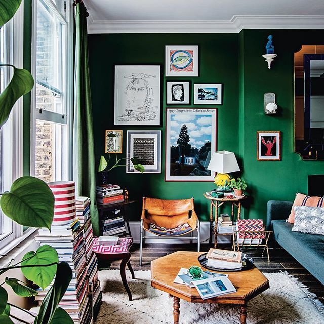 INTERIORS: From the new issue of Vogue Living, rising London design stars Luke Edward Hall and Duncan Campbell share a three-roomed at in a converted Victorian terrace house in Camden, north London. Here, in a view of the living area, sofas from sofa.com; cushions designed by Hall; vintage items include leather chair from Pamono, coffee table, brass bamboo magazine rack and faux bamboo side table. By @thechicshopper Photographed by @helenio_barbetta Produced and styled by @chiara_dal_canto…