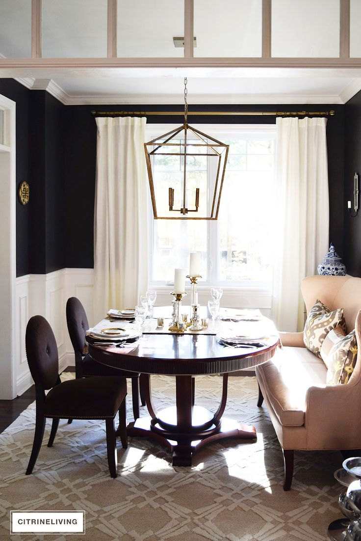 Adding a neutral rug and drapes in our dining room helped to add a subdued yet sophisticated look to an eclectic space.