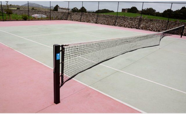 Peter Fell Coloured Concrete | Green concrete tennis court, and coloured basketball court too