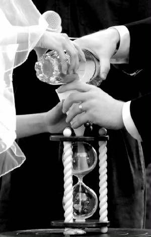 Heirloom hourglass wedding unity sand ceremony.