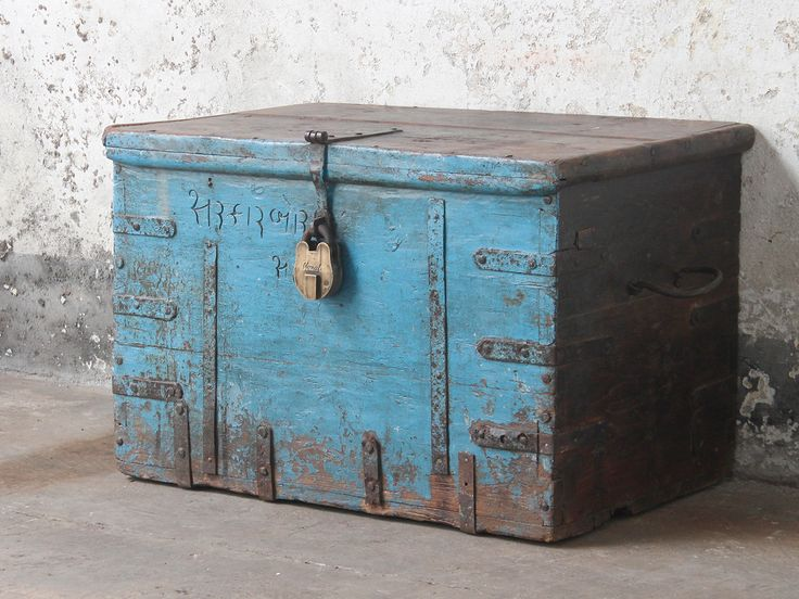 A lovely large antique blue wooden chest with iron corner straps and carved Indian text. A real statement piece with its original faded blue colour. It would look great in an eclectically styled livingroom or at the end of a bed as linen storage chest or blanket box. We stock one of the widest ranges of old wooden boxes in the UK. Our stock of old wooden boxes changes every week