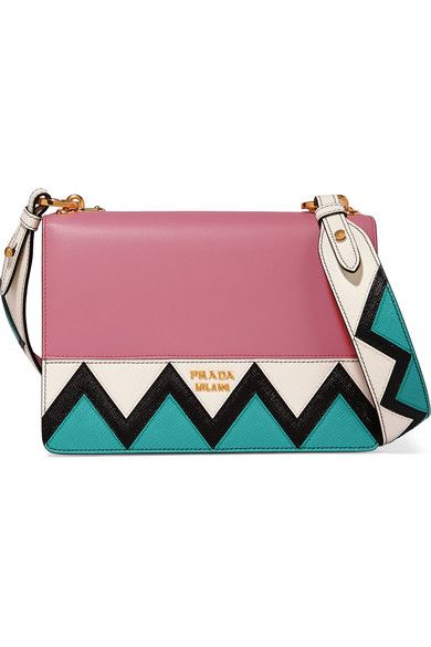Pink leather, turquoise, black and white textured-leather (Calf) Snap-fastening front flap Weighs approximately 1.5lbs/ 0.7kg Made in Italy