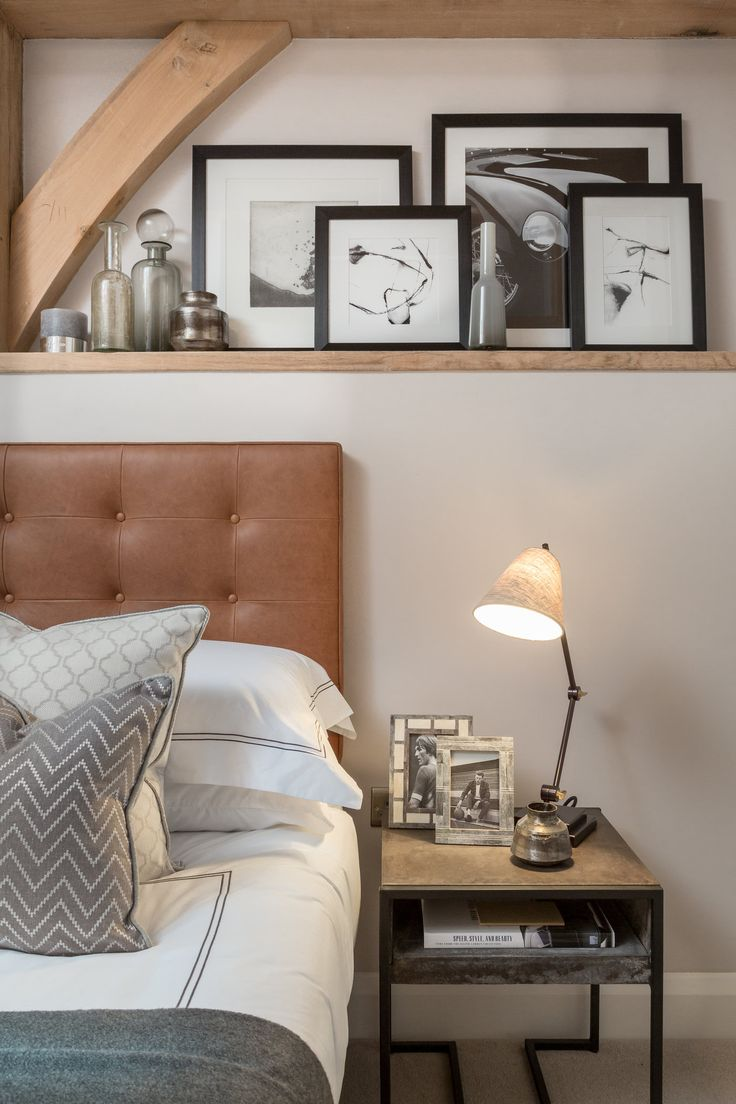 These monochrome gallery of images add vibrance and personality to our modern Surrey barn bedroom, whilst the grey soft furnishings add warmth and comfort to this stylish design