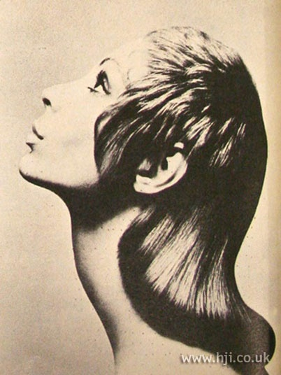 1969 mid length straight hairstyle  Mid length hair was blow-dried straight through the back with soft, short waves through the front     Hairstyle by: Roger Thompson  Salon: Vidal Sassoon  Location: London