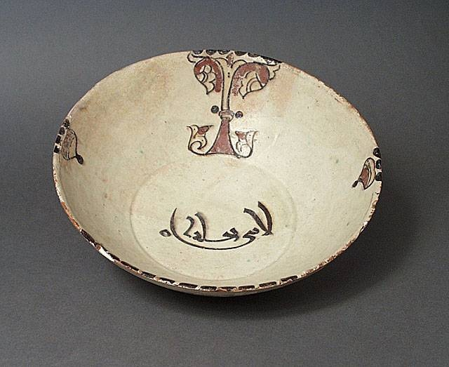 Bowl Greater Iran, Nishapur or Samarquand Bowl, 10th century Ceramic; Vessel, Earthenware, white slip, underglaze-painted, 3 1/2 x 10 in. (8.89 x 25.4 cm) The Nasli M. Heeramaneck Collection, gift of Joan Palevsky (M.73.5.330) Art of the Middle East: Islamic Department.