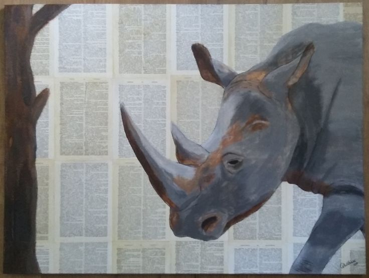 Rhinoceros on a background of old dictionary paper