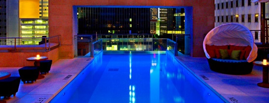 the pool at The Joule in Dallas, TX reaches 8 feet beyond the hotel's structure and includes a glass window at its end, providing swimmers with the sensation of swimming off the building's edge.
