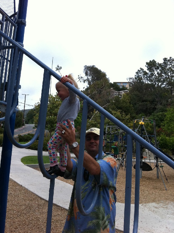 Stephane Marchand is the founder of Altitude Entertainment Company. He is playing with his little daughter in park at Newport Coast, CA.