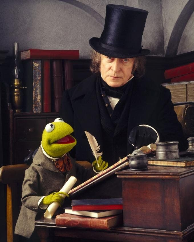 Ebenezer Scrooge is the main character in The Muppet Christmas Carol. A shrewd and coldhearted moneylender, Scrooge is the sole surviving member of the firm of Scrooge and Marley, following the deaths of his partners Jacob and Robert Marley. He browbeats his bookkeepers, especially his clerk Bob Cratchit, and is universally despised, even by his own nephew, Fred. Following a ghostly visitation by the Marleys, and by the Ghost of Christmas Past, Ghost of Christmas Present, and Ghost of...