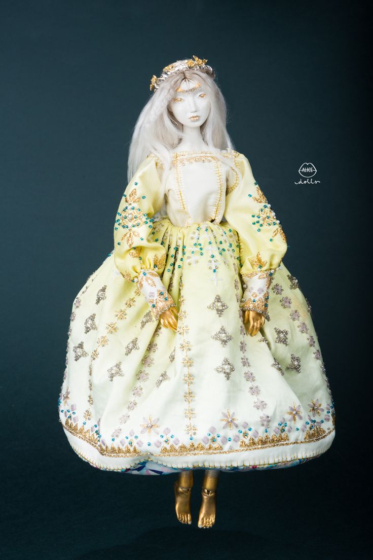 Limoges Porcelain/ Painted with Gold& Platinum Luster/ Swarovski crystals & Pearls / Gold-plated Silver crown / Hand embroidered costume / Cotton & Natural Silk costume / Original Alice…